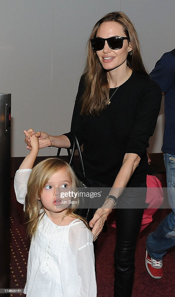 <a gi-track='captionPersonalityLinkClicked' href=/galleries/search?phrase=Angelina+Jolie&family=editorial&specificpeople=201591 ng-click='$event.stopPropagation()'>Angelina Jolie</a> and Vivienne Jolie-Pitt arrive at Tokyo International Airport on July 28, 2013 in Tokyo, Japan.