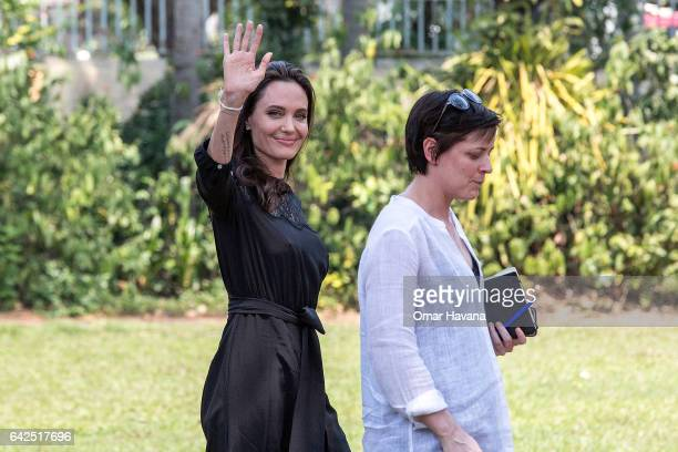 Angelina Jolie greets members of the press while leaving a press conference ahead of the premiere of her new film 'First They Killed My Father' set...
