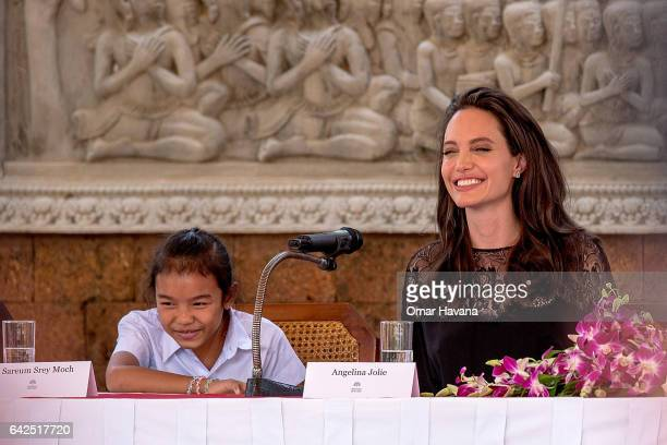 Angelina Jolie laughs with actress Sareum Srey Moch during a press conference ahead of the premiere of their new movie 'First They Killed My Father'...