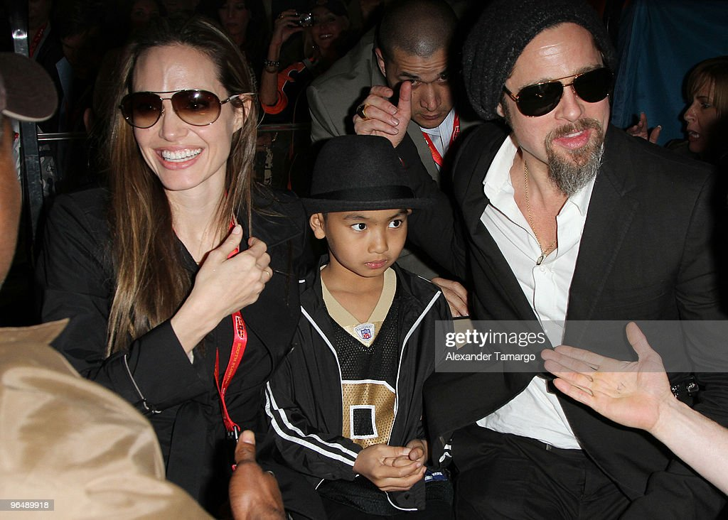Angelina Jolie, Maddox Jolie-Pitt and Brad Pitt are seen leaving Super Bowl XLIV at Sun Life Stadium on February 7, 2010 in Miami Gardens, Florida.