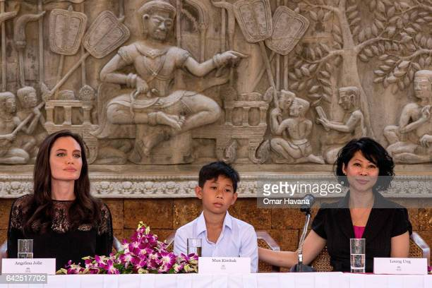 Angelina Jolie Mun Kimhak and author Loung Ung hold a press conference ahead of the premiere of their new movie 'First They Killed My Father' set up...