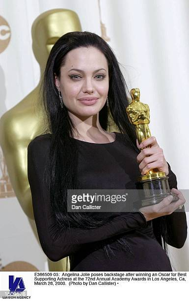 Angelina Jolie poses backstage after winning an Oscar for Best Supporting Actress at the 72nd Annual Academy Awards in Los Angeles Ca March 26 2000