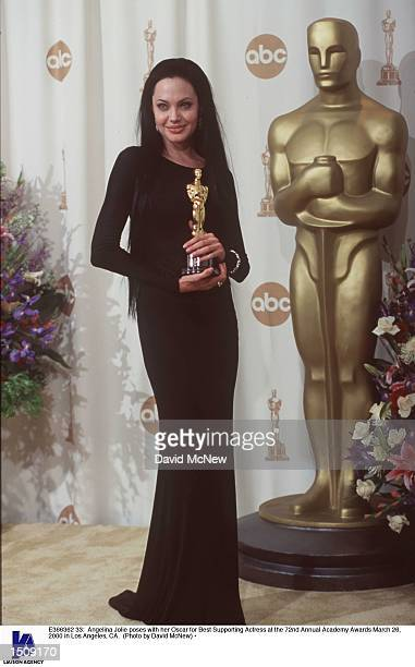 Angelina Jolie poses with her Oscar for Best Supporting Actress at the 72nd Annual Academy Awards March 26 2000 in Los Angeles CA