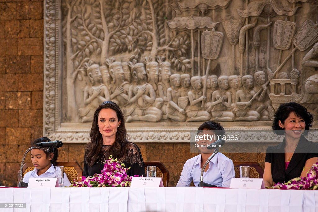 Angelina Jolie (center), Sareum Srey Moch (left), Mun Kimhak (center-right) and Loung Ung (right) hold a press conference ahead of the premiere of their new film 'First They Killed My Father' set up at the Raffles Grand Hotel D'Angkor on February 18, 2017 in Siem Reap, Cambodia. Angelina Jolie is in Siem Reap for the world premiere of her new movie, 'First They Killed my Father,' a Netflix-produced adaption of the autobiography by the same name penned by Loung Ung, who lived through the Khmer Rouge regime as a young child. The film will be screened Saturday night in the Angkor Wat temple complex, and released later this year on Netflix.