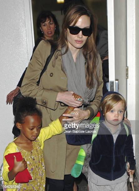 Angelina Jolie Shiloh and Zahara arrive at LAX Airport on September 18 2010 in Los Angeles California