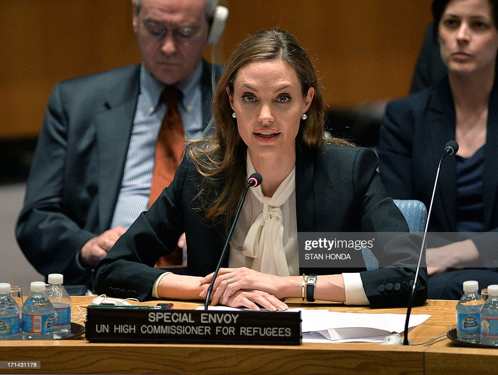 <a gi-track='captionPersonalityLinkClicked' href=/galleries/search?phrase=Angelina+Jolie&family=editorial&specificpeople=201591 ng-click='$event.stopPropagation()'>Angelina Jolie</a>, Special Envoy, United Nations High Commissioner for Refugees, speaks before a United Nations Security Council meeting on Women and Peace and Security and Sexual Violence in Conflict June 24, 2013 at UN headquarters in New York. Jolie on Monday criticized UN Security Council powers for their lack of action over wartime rapes, invoking Syria and other conflicts in a surprise speech to the body. Ambassadors from Russia, China, the United States, France and Britain -- bitterly divided over the Syria war -- listened as Jolie said they should 'show the determination' to defend the hundreds of thousands of victims of sexual attacks in conflict. AFP PHOTO/Stan HONDA