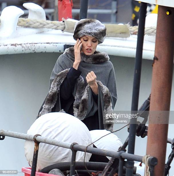 Angelina Jolie takes a break from filming on location for 'Salt' on a boat in the Hudson River on December 28 2009 in New York City