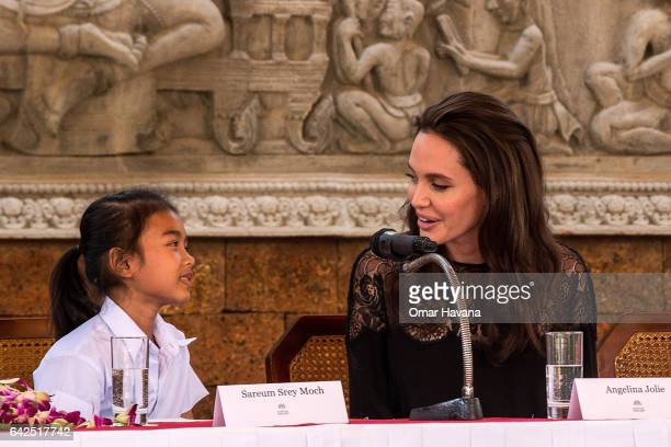 Angelina Jolie talks to actress Sareum Srey Moch during a press conference ahead of the premiere of their new movie 'First They Killed My Father' set...