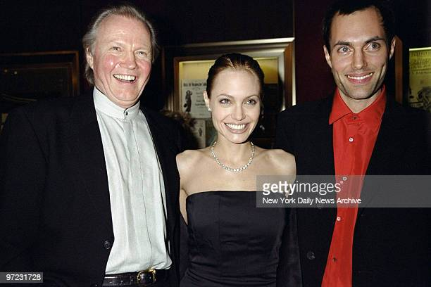 Angelina Jolie with her father actor John Voight and her brother James Haven at premiere of the movie 'The Bone Collector' at the Ziegfeld Theater...