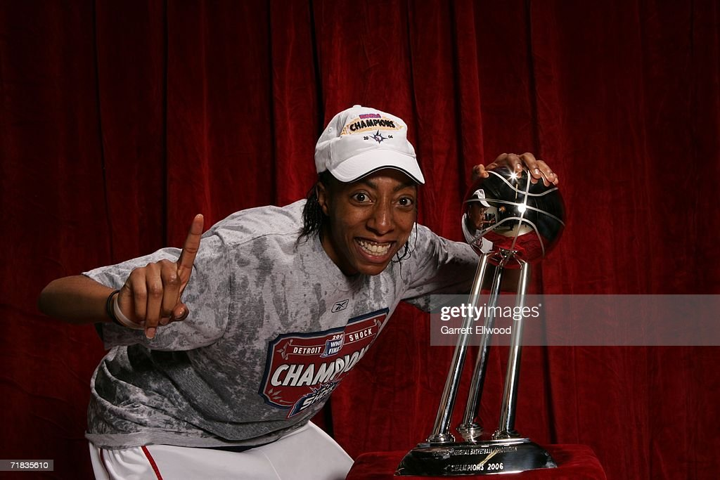 Angelina Williams of the 2006 WNBA Champion Detroit Shock celebrates with the WNBA Championship trophy after winning Game Five of the WNBA Finals 80...