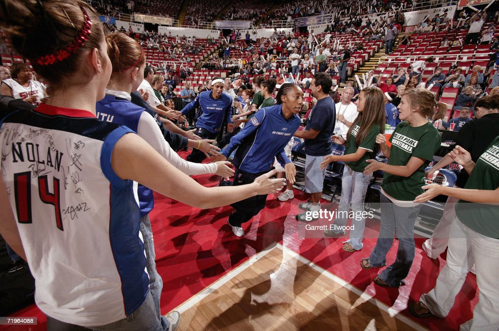 Angelina Williams of the Detroit Shock enters the court before taking on the Sacramento Monarchs in Game Five of the WNBA Finals September 9 2006 at...