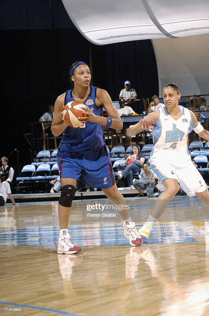 Angelina Williams of the Detroit Shock looks to pass the ball against Candice Dupree of the Chicago Sky on June 4 2006 at the UIC Pavilion in Chicago...