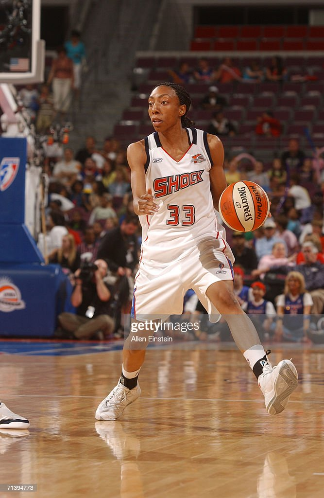 Angelina Williams of the Detroit Shock moves the ball against the Minnesota Lynx during the game at the Palace of Auburn Hills in Detroit Michigan on...