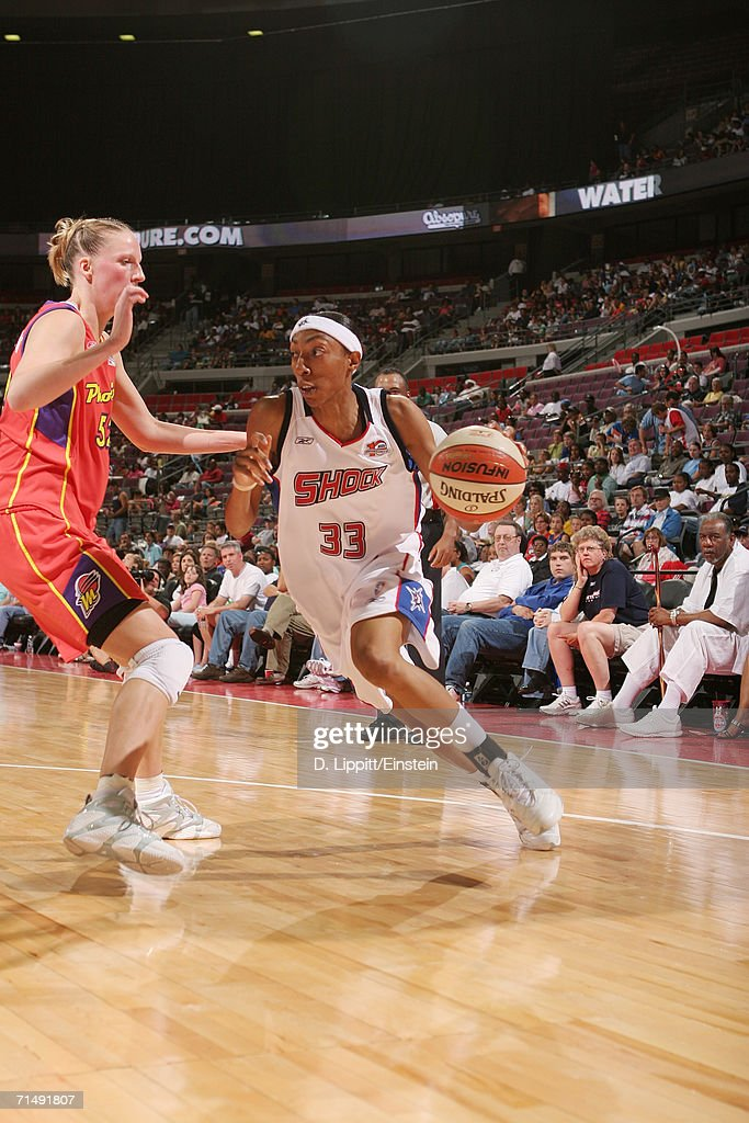Angelina Williams of the Detroit Shock moves the ball against the Phoenix Mercury on July 6 2006 at the Palace of Auburn Hills in Auburn Hills...