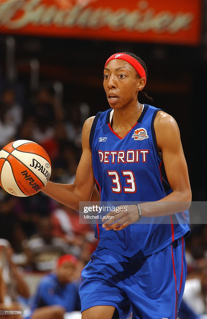 Angelina Williams of the Detroit Shock moves the ball up court during a game against the Washington Mystics at MCI Center on August 11 2006 in...