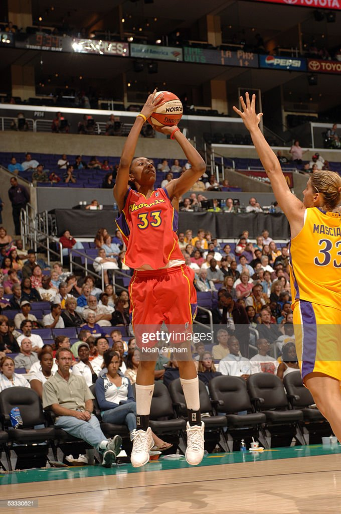 Angelina Williams of the Phoenix Mercury attempts a shot over Raffaella Masciadri of the Los Angeles Sparks on July 2 2005 at Staples Center in Los...