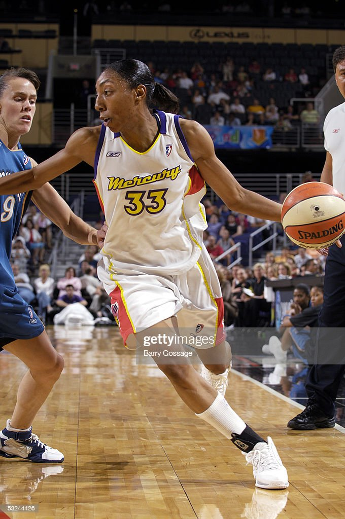 Angelina Williams of the Phoenix Mercury dribbles against the Washington Mystics July 15 2005 at America West Arena in Phoenix Arizona NOTE TO USER...