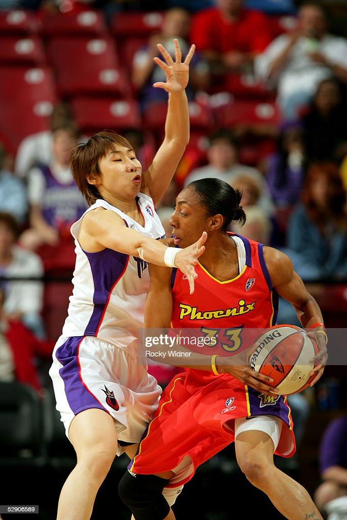 Angelina Williams of the Phoenix Mercury is defended by Miao Lijie of the Sacramento Monarchs during the preseason game on May 12 2005 at Arco Arena...