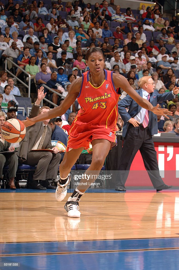 Angelina Williams of the Phoenix Mercury moves the ball against the Washington Mystics during a WNBA game June 21 2005 at the MCI Center in...
