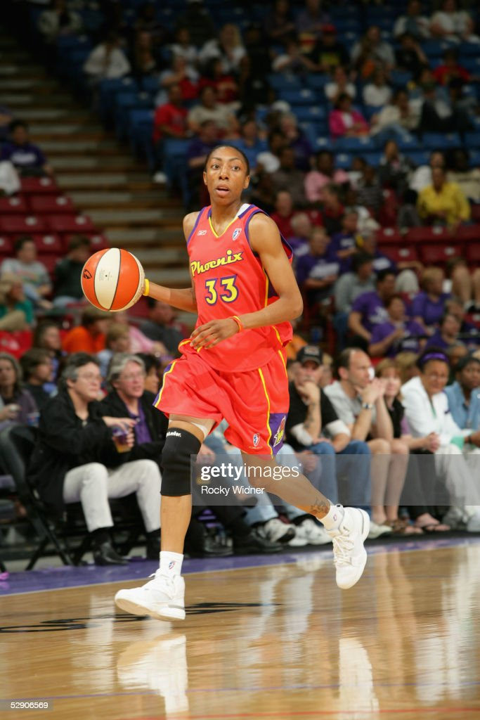 Angelina Williams of the Phoenix Mercury moves the ball during the preseason game against the Sacramento Monarchs on May 12 2005 at Arco Arena in...