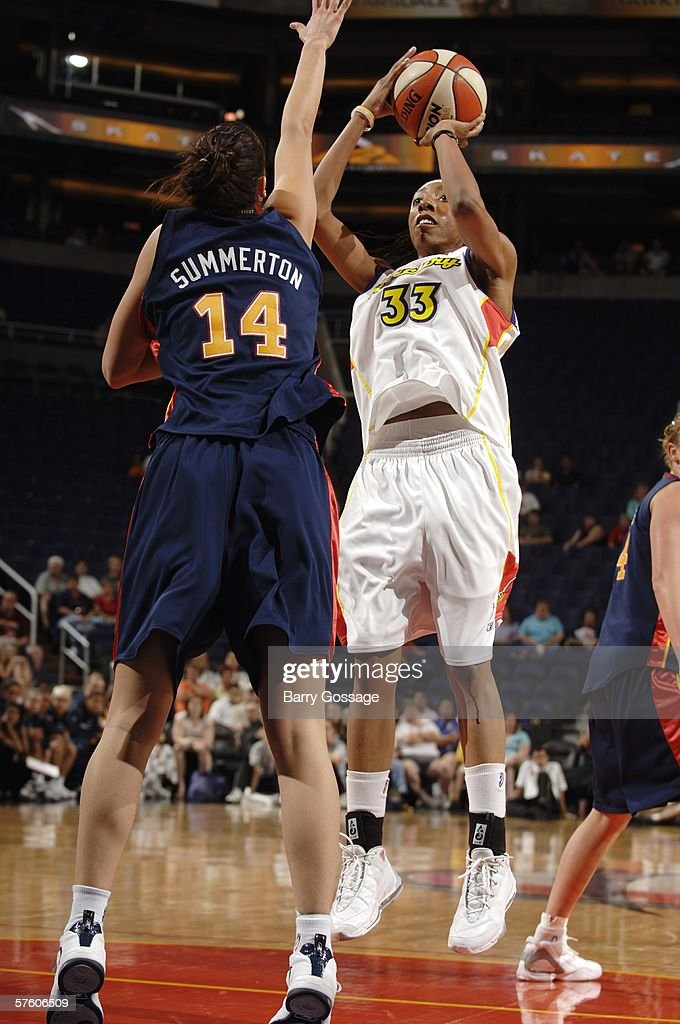 Angelina Williams of the Phoenix Mercury shoots against Laura Summerton of the Connecticut Sun during their preseason WNBA game on May 13 2006 at US...