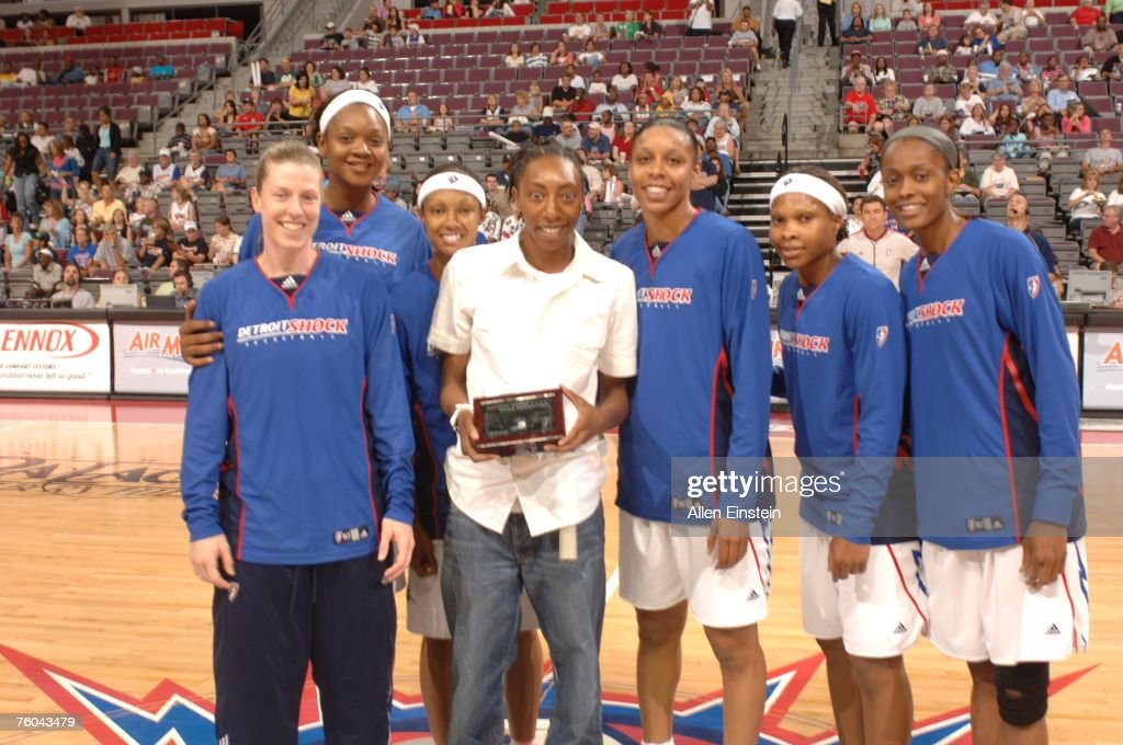 Angelina Williams of the Seattle Storm receives her Championship ring from last season when she was with the the Detroit Shock on August 9 2007 at...
