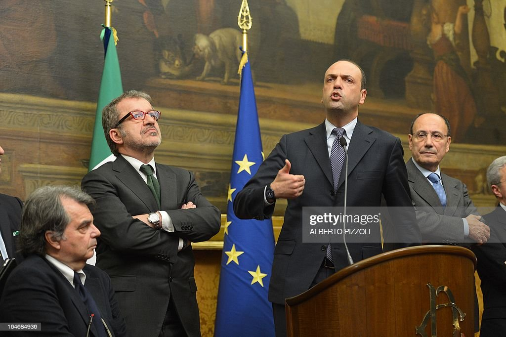 Angelino Alfano (2ndR), general secretary of centre-right People of Freedom party (PDL) speaks during a press conference following a meeting with leftist leader Pier Luigi Bersani on March 26, 2013 at the Italian lower-house in Rome. Bersani was given the official go-ahead on March 23, 2013 to try and form a government after February elections that left the country in political gridlock.
