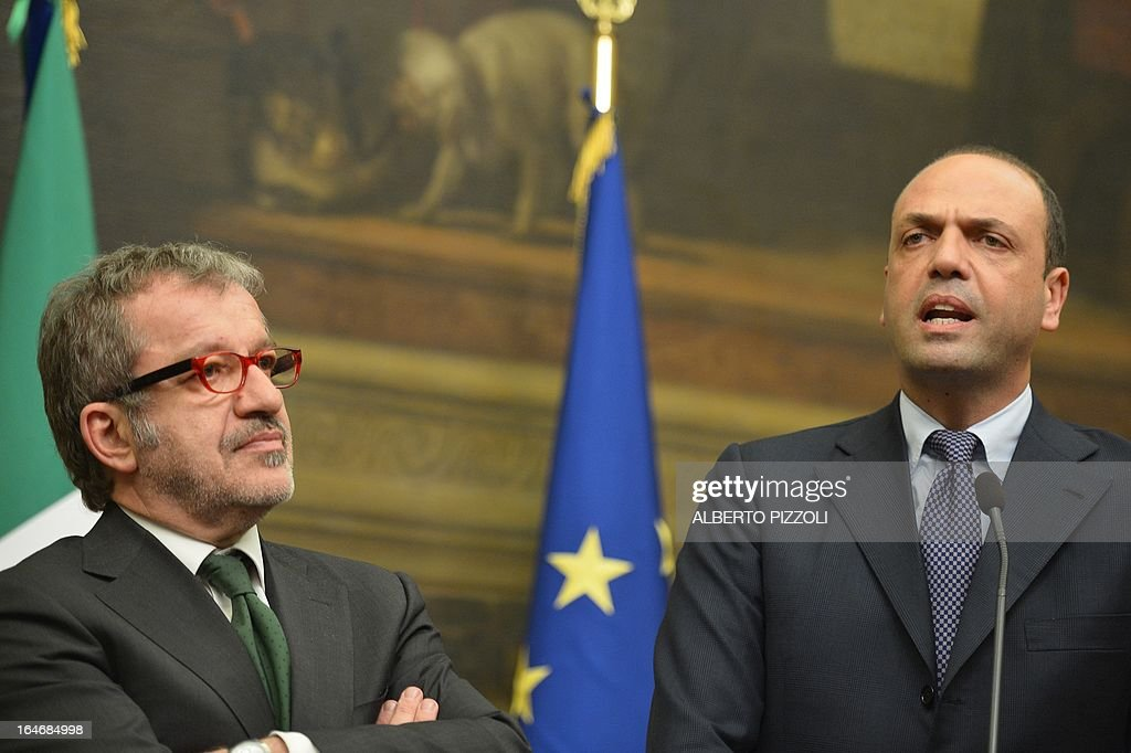 Angelino Alfano (R), general secretary of centre-right People of Freedom party (PDL) speaks next to Lega Nord (North League) party, Roberto Maroni, during a press conference following a meeting with leftist leader Pier Luigi Bersani on March 26, 2013 at the Italian lower-house in Rome. Bersani was given the official go-ahead on March 23, 2013 to try and form a government after February elections that left the country in political gridlock.