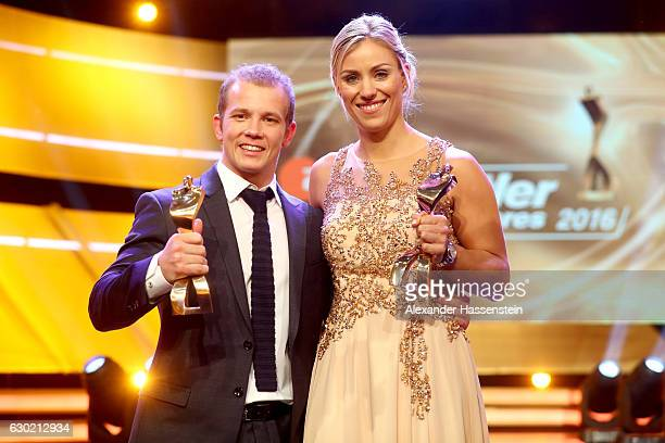 Angelique Kerber and Fabian Hambuechen poses with their Sportler des Jahres 2016 awards during the Sportler des Jahres 2016 gala at Kurhaus...