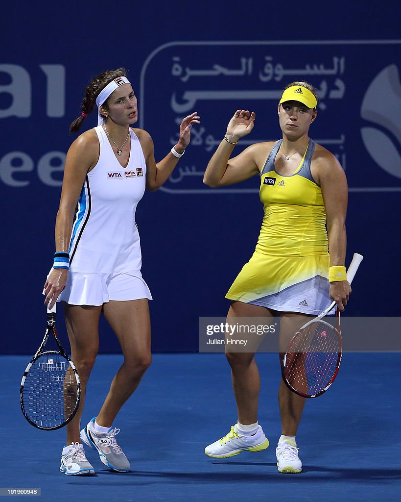 Angelique Kerber (R) and Julia Goerges of Germany look on in their first round doubles match against Janette Husarova of Slovakia and Shuai Zhang of China during day one of the WTA Dubai Duty Free Tennis Championship on February 18, 2013 in Dubai, United Arab Emirates.