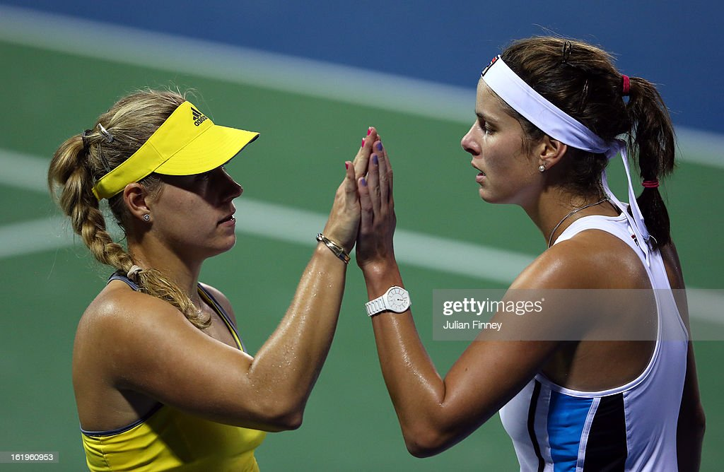 Angelique Kerber (L) and Julia Goerges of Germany support each other in their first round doubles match against Janette Husarova of Slovakia and Shuai Zhang of China during day one of the WTA Dubai Duty Free Tennis Championship on February 18, 2013 in Dubai, United Arab Emirates.