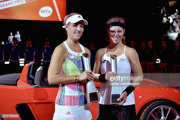 Angelique Kerber and Laura Siegemund of Germany celebrate with the trophy after the singles final match on Day 7 of the Porsche Tennis Grand Prix at...
