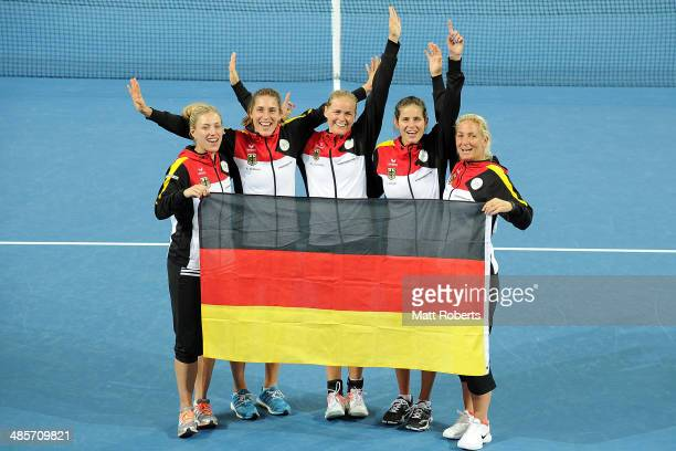 Angelique Kerber Andrea Petkovic AnnaLena Groenefeld Julia Goerges and Barbara Rittner pose for a photograph after during the Fed Cup Semi Final tie...