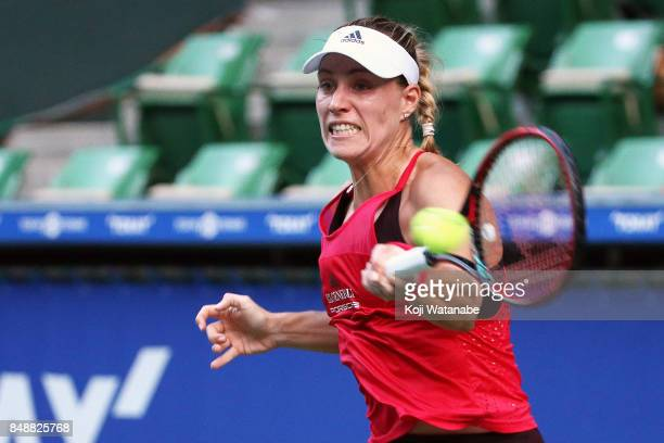 Angelique Kerber of German plays a backhand in her match against Naomi Osaka of Japan during women's singles match day one of the Toray Pan Pacific...