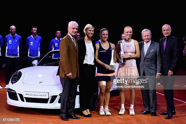 Angelique Kerber of Germany and Caroline Wozniacki of Denmark pose after their final match during Day 7 of the Porsche Tennis Grand Prix on April 26...