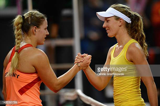 Angelique Kerber of Germany and Olivia Rogowska of Australia shake hands after their match during day two of the Federation Cup 2012 World Group...