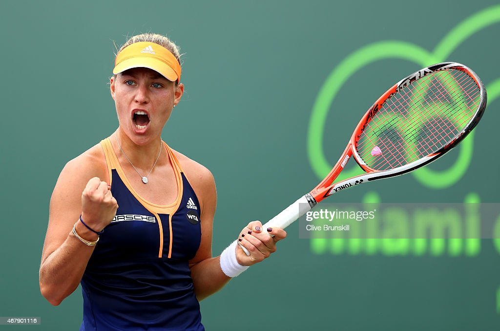 <a gi-track='captionPersonalityLinkClicked' href=/galleries/search?phrase=Angelique+Kerber&family=editorial&specificpeople=4307332 ng-click='$event.stopPropagation()'>Angelique Kerber</a> of Germany celebrates a point against Heather Watson of Great Britain in their second round match during the Miami Open Presented by Itau at Crandon Park Tennis Center on March 28, 2015 in Key Biscayne, Florida.