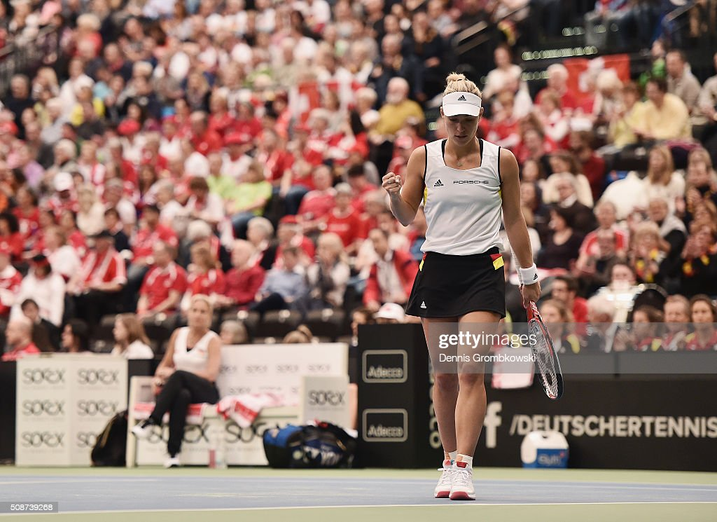 <a gi-track='captionPersonalityLinkClicked' href=/galleries/search?phrase=Angelique+Kerber&family=editorial&specificpeople=4307332 ng-click='$event.stopPropagation()'>Angelique Kerber</a> of Germany celebrates a point in her match against Timea Bacsinszky of Switzerland during Day 1 of the 2016 Fed Cup World Group First Round match between Germany and Switzerland at Messe Leipzig on February 6, 2016 in Leipzig, Germany.