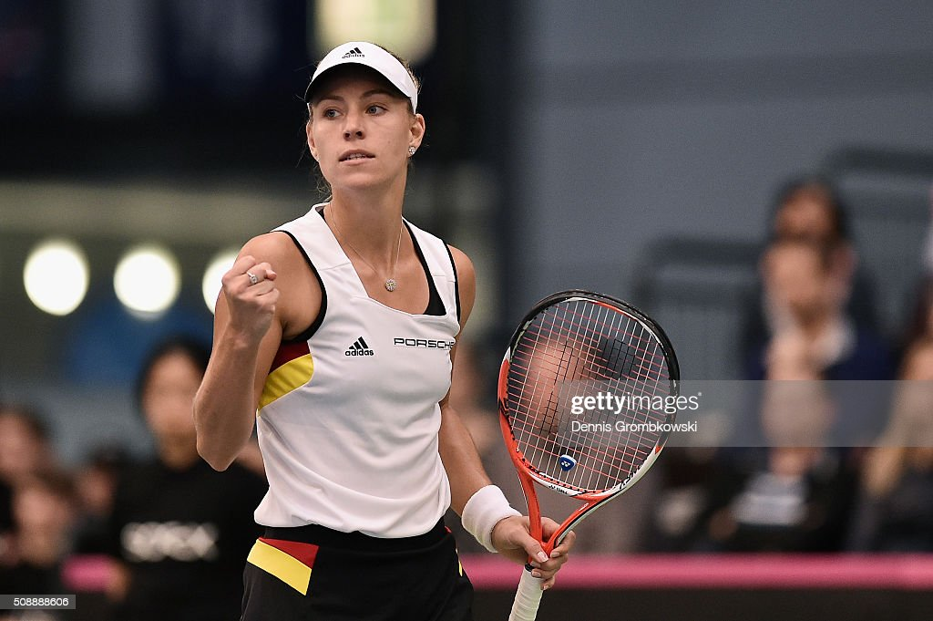 <a gi-track='captionPersonalityLinkClicked' href=/galleries/search?phrase=Angelique+Kerber&family=editorial&specificpeople=4307332 ng-click='$event.stopPropagation()'>Angelique Kerber</a> of Germany celebrates a point in her match against Belinda Bencic of Switzerland on Day 2 of the 2016 FedCup World Group Round 1 match between Germany and Switzerland at Messe Leipzig on February 7, 2016 in Leipzig, Germany.