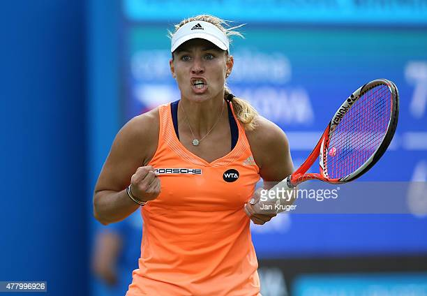 Angelique Kerber of Germany celebrates a point in her singles final match against Karolina Pliskova of Czech Republic on day seven of the Aegon...