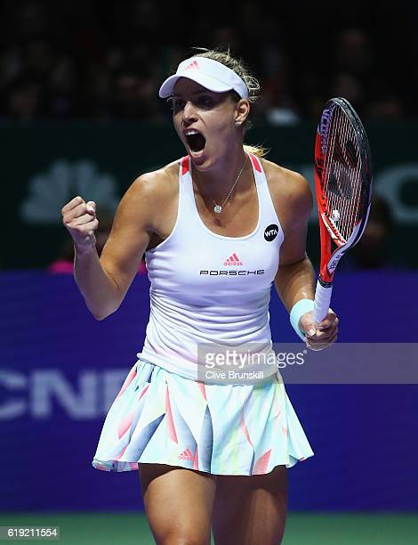 Angelique Kerber of Germany celebrates a point in her singles final against Dominika Cibulkova of Slovakia during day 8 of the BNP Paribas WTA Finals...