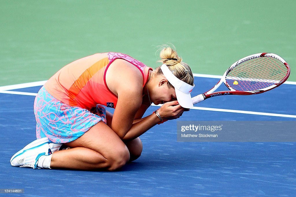 <a gi-track='captionPersonalityLinkClicked' href=/galleries/search?phrase=Angelique+Kerber&family=editorial&specificpeople=4307332 ng-click='$event.stopPropagation()'>Angelique Kerber</a> of Germany celebrates after defeating Flavia Pennetta of Italy during Day Eleven of the 2011 US Open at the USTA Billie Jean King National Tennis Center on September 8, 2011 in the Flushing neighborhood of the Queens borough of New York City.