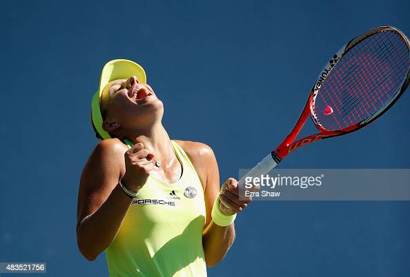 Angelique Kerber of Germany celebrates after she beat Karolina Pliskova of the Czech Republic in the finals on Day 7 of the Bank of the West Classic...