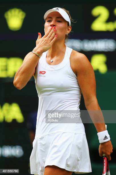 Angelique Kerber of Germany celebrates after winning her Ladies' Singles fourth round match against Maria Sharapova of Russia on day eight of the...