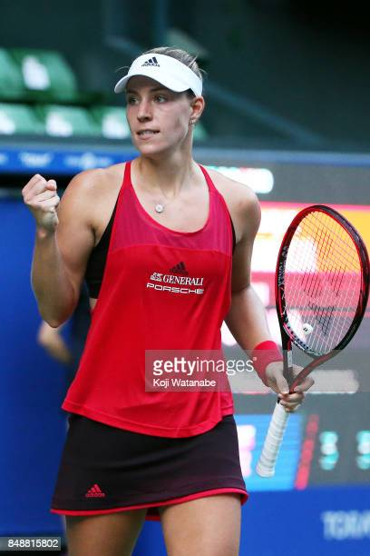 Angelique Kerber of Germany celebrates defeating Naomi Osaka of Japan during women's singles match on day one of the Toray Pan Pacific Open Tennis at...