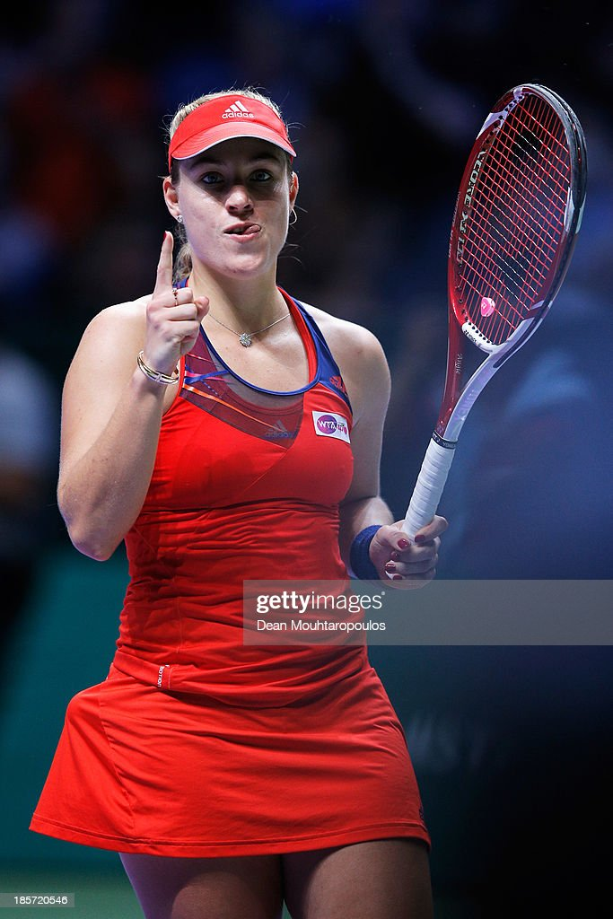 <a gi-track='captionPersonalityLinkClicked' href=/galleries/search?phrase=Angelique+Kerber&family=editorial&specificpeople=4307332 ng-click='$event.stopPropagation()'>Angelique Kerber</a> of Germany celebrates her victory over Agnieszka Radwanska of Poland during day three of the TEB BNP Paribas WTA Championships at the Sinan Erdem Dome October 24, 2013 in Istanbul, Turkey.