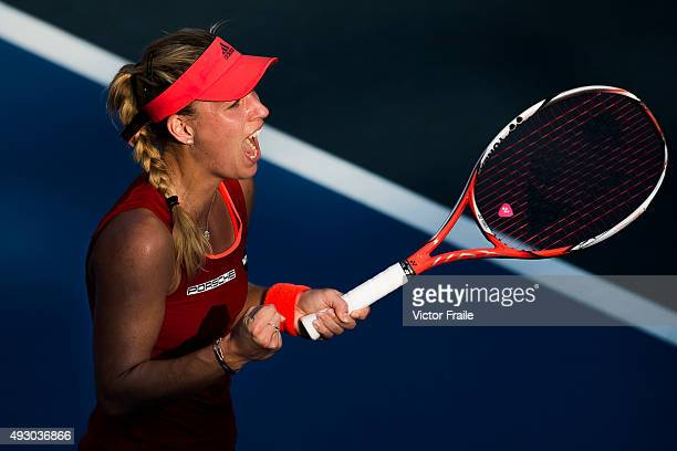 Angelique Kerber of Germany celebrates her victory over Samantha Stosur of Australia during the WTA Prudential Hong Kong Open at the Victoria Park...