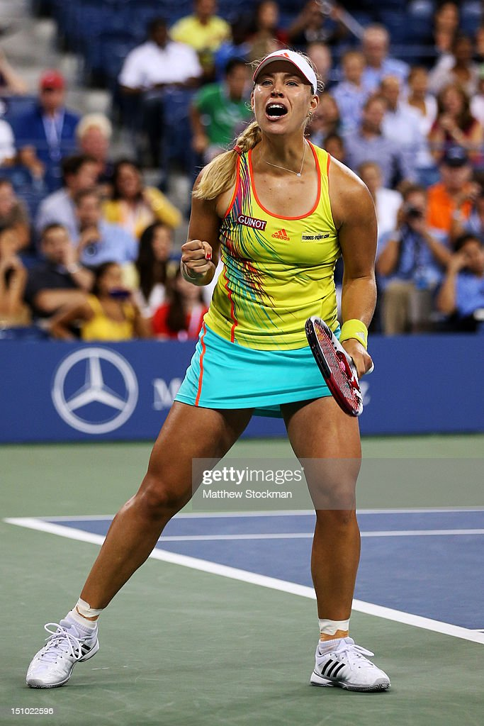 <a gi-track='captionPersonalityLinkClicked' href=/galleries/search?phrase=Angelique+Kerber&family=editorial&specificpeople=4307332 ng-click='$event.stopPropagation()'>Angelique Kerber</a> of Germany celebrates match point after her women's second round match against Venus Williams of the United States on Day Four of the 2012 US Open at USTA Billie Jean King National Tennis Center on August 30, 2012 in the Flushing neigborhood of the Queens borough of New York City.