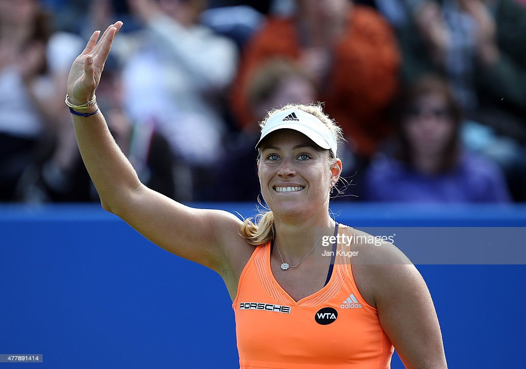 <a gi-track='captionPersonalityLinkClicked' href=/galleries/search?phrase=Angelique+Kerber&family=editorial&specificpeople=4307332 ng-click='$event.stopPropagation()'>Angelique Kerber</a> of Germany celebrates the win over Sabine Lisicki of Germany during their semi final match on day six of the Aegon Classic at Edgbaston Priory Club on June 20, 2015 in Birmingham, England.
