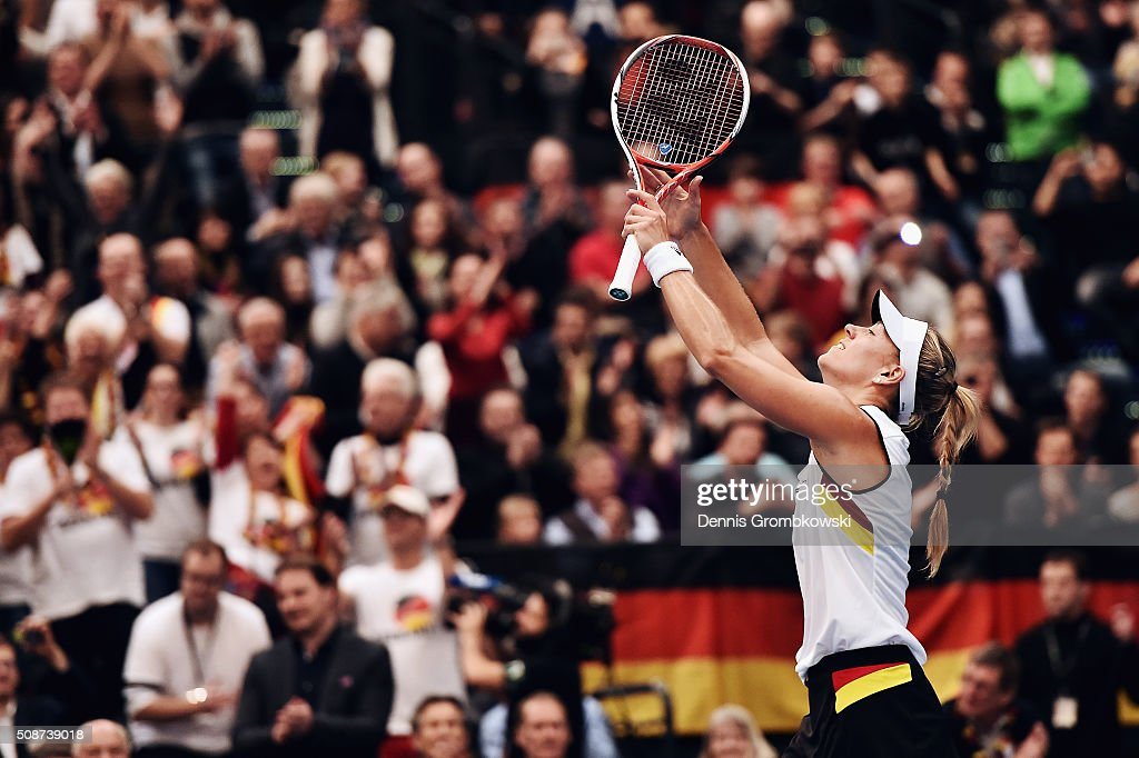 <a gi-track='captionPersonalityLinkClicked' href=/galleries/search?phrase=Angelique+Kerber&family=editorial&specificpeople=4307332 ng-click='$event.stopPropagation()'>Angelique Kerber</a> of Germany celebrates victory in her match against Timea Bacsinszky of Switzerland during Day 1 of the 2016 Fed Cup World Group First Round match between Germany and Switzerland at Messe Leipzig on February 6, 2016 in Leipzig, Germany.